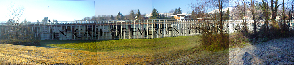 Proposal image for Talponia apartment complex in Ivrea Italy, In Case of Emergency Break Glass, vinyl lettering on glass